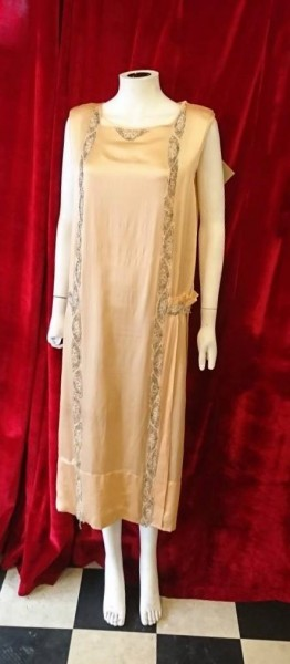 Pretty 1920's peach silk flapper dress. Amazing wearable condition with lovely silver bead detail.